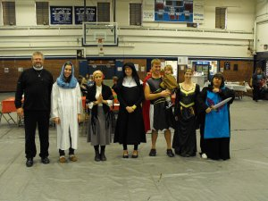 Yes, that is my husband in the skirt!! He was St. Michael, I was St. Cecilia.